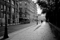 Early Morning in Paris - with a shadow taller than herself, she knows he will remember her forever.