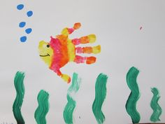 Handprint Rainbow Fish. These colorful fish are easy to create and easy to modify to suit different abilities. The staff helped to paint each child's hand and then place it on the paper sideways. Then the students added seaweed, bubbles, and a face to the fish. Preschool Auction Projects, Preschool Ideas, Baby Crafts, Crafts For Kids, Arts And Crafts, Fish Handprint, Infant Curriculum, Rainbow Fish, Under The Sea Party