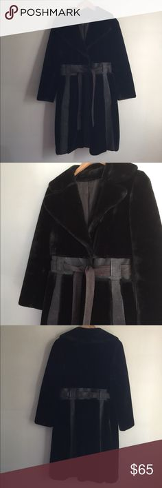 Faux fur coat Beautiful fur coat , dark brown color and brown leather accents including a belt. Two pockets and silk lining . A small rip on the armpit but outside is perfect condition Saks Fifth Avenue Jackets & Coats