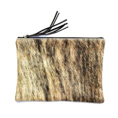 The cowhide Jem by Mooi is our maxi pouch that fits neatly under your arm, use as an ipad case or super sized make-up purse when travelling. This clutch pouch can me used for a wide variety of tasks. This case is the perfect size and snugly fits an ipad. Excellent to protect your ipad while in your handbag from keys and other potentially damaging items! We love the idea that know one will know that your valuable ipad is inside this pouch especially if you have an open top style maxi handbag.
