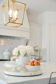Updated Home Details - Decor Gold Designs kitchen lantern light pendant brass Kitchen Island Decor, Home Decor Kitchen, Home Kitchens, Kitchen Design, How To Decorate Kitchen Island, Kitchen Island Centerpiece, Spring Kitchen Decor, Kitchen Staging, Kitchen Vignettes