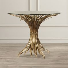 Features:  -Material: Iron.  -Color: Antique gold leaf.  Shape: -Round.  Design: -Table.  Style: -Traditional.  Top Finish: -Clear.  Base Finish: -Antique gold leaf.  Base Type: -Pedestal. Dimensions:                                                                                                                                                                                 More
