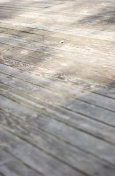Power washing is one of the fastest ways to clean a wood deck, but it can ruin the deck just as fast if you aren't careful. The high-pressure water removes the surface layer from the wood and ...