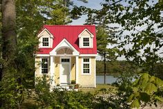 This darling red-roofed cottage sits in a grove of leafy trees near the water's edge in Freeport, Maine. Designed by Mac Lloyd of Creative Cottages, the environmentally sensitive abode packs in a full kitchen, bathroom, living space, sleeping quarters, gas fireplace, laundry, and a loft space, while still managing to seem airy and spacious.  Look inside the Oceanside Retreat.