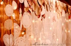 doily garland never thought about this. This would be so inexpensive to do. You can buy a pack of these for a dollar and use pretty lace ribbion to make it look better.