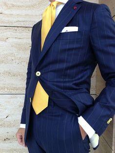 Navy pin stripe suit, yellow tie