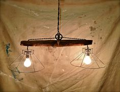 Rustic Primitive Hanging Pendant Lights / Upcycled Farm Implements / Handmade. $185.00, via Etsy.