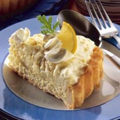 Lemon Chiffon Charlotte made with lady fingers, whipping cream and lemon curd.. can't wait to make this!