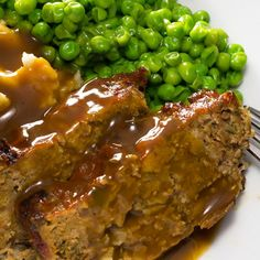 This delicious meatloaf with gravy recipe is easy to prepare and the gravy adds an additional juicy flavor to the meal. Great with mashed potatoes and peas. Meatloaf With Gravy Recipe from Grandmothers Kitchen. Meatloaf Gravy Recipe, Meatloaf With Gravy, Meatloaf Recipes, Meat Recipes, Cooking Recipes, Recipes With Beef Gravy, Meatloaf Sauce, Healthy Meatloaf, Amish Recipes