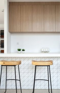 Take this 4 inch triangle chip size, matte finish and pure white color, with a linear pattern, going to make a statement to your kitchen island design. #homedecor #interiordesign