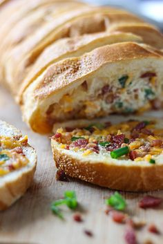 An easy, cheesy, bacon bread appetizer for a big crowd. With creamy butter, cheddar cheese, bacon pieces and green onions!!