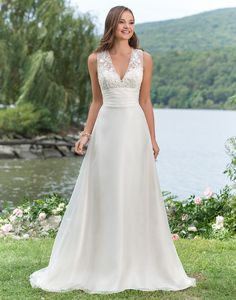 Sweetheart Gowns sweetheart style 6151 Look charming at any outdoor venue in this slim A-line charmeuse and organza gown with a V-neckline, corded lace bodice, illusion back, natural waistline, and sweep train.