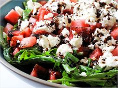 Watermelon, Feta and Arugala salad...this is my absolute favorite salad during the summer.  FYI use a balsamic glaze and just drizzle a little and its perfection. Try it with raspberry vinaigrette... it's amazing and add red  onions