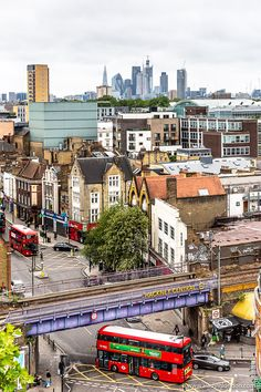 A beautiful view of London from St Augustine's Tower in Hackney. This historic landmark has great views over east London and the London skyline, not to mention classic double decker buses. London View, London Bus, East London, Amazing Places, Beautiful Places, Places To Travel, Places To Visit, London History, London Skyline