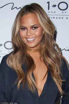 Glamour girl:Her amber waves cascaded around her shoulders, and a smokey eye and bronzed ...
