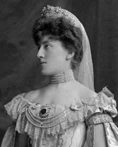 A rather clearer image of Agnes, Baroness Stoeckl, wearing a tiara with multiple diamond stars topping a fringe-like base. More info. http://lafayette.org.uk/sto3364.html