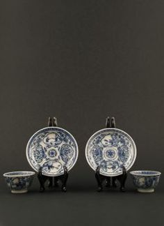 Qianlong - Two blue and white miniature cups and saucers with decor of a woman and a boy and alternating flower panels