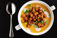 This is certainly a twist on a classic. l Butternut Squash Soup with Smoked Gouda and Spicy Chickpeas