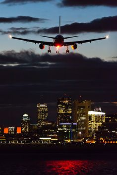 The anti-collision light reflects red off Winthrop Harbor as this American lands RWY 27 at night.