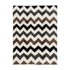 Fun mix of Gray, Chocolate, Black, and White come together in this Natural & Multi Trevor Shag Carpet