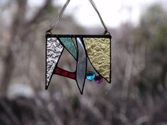 Favorite  Like this item?    Add it to your favorites to revisit it later.  Mini Stained Glass Valance Suncatcher textured sea green, gold, blue, bergundy, turquoise, purple