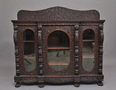 A fabulous quality 19th Century Burmese carved breakfront three door cabinet, profusely carved all over with pierced and carved flowers, foliage and vines, having a nice figured top with a shaped back carved and pierced with further foliage and vines, lovely decorative frieze below the top, the upright pillars that hold the doors are carved with mythical heads and carved floral decoration, each door having oval glazed panels. c1870. Antiques Atlas #antiquedisplaycabinet #burmeseantiques Antique Display Cabinets, Burmese, Wall Groupings, Closet Lighting, Teak, 19th Century, Modern Furniture, Carving, Vines