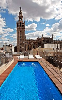 POOLS | Hotel Eme Fusion in Sevilla, España. Rooftop city centre bathing with a Cathedral backdrop. #Hotel #Eme #Fusion #Sevilla #España #Seville #Spain #Rooftop #City #Centre #Bathing #Cathedral #Swimming