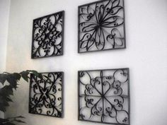 DIY Faux Wrought Iron Wall Art using toilet paper/paper towel rolls and frames.
