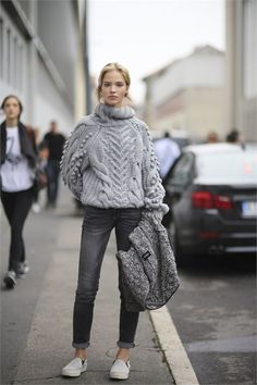 Pairing a grey knit jumper with charcoal slim jeans is a comfortable option for running errands in the city. Grey slip-on sneakers will contrast beautifully against the rest of the look.  Shop this look for $33:  http://lookastic.com/women/looks/grey-slip-on-sneakers-charcoal-skinny-jeans-grey-cable-sweater/4862  — Grey Slip-on Sneakers  — Charcoal Skinny Jeans  — Grey Cable Sweater