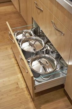 A deep drawer under the cooktop is designed to accommodate large pots with their lids in place. The drawer glides open easily, even when fully loaded.