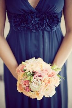 Navy/peach «use more peach for the bouquets, and blue for the other centrepieces