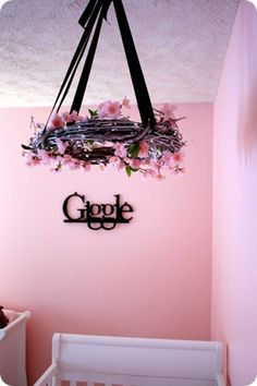 DIY hanging flower mobile - could do with some stuffed animal birds/ an owl