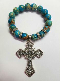 Turquoise Lace Agate is paired beautifully with a jeweled Reflection Cross. *All designs can be altered using the beads of your choice. Lace Agate, Natural Gemstones, Reflection, Beaded Bracelets, Turquoise, Couture, Beads, Jewelry, Fashion