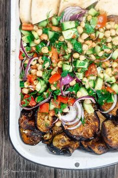 True to the Mediterranean diet, this chickpea salad w/ fried eggplant is  vibrant and satisfying. W/ chopped vegetables, herbs, Za'atar & garlic viniagrette