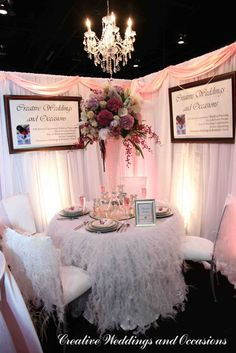 Pink and white design for Calgary Bridal Expo 2010 booth - Romantic Fantasy. Features linens from Wildflower Linen.