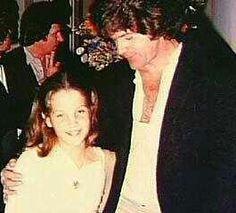 Lisa between 9-11 with Jerry Schilling