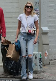 Laid-back: Victoria's Secret Angel Elsa Hosk kept casual in distressed jeans and a T-shirt...