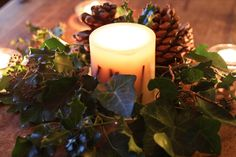 Candle Centrepiece w/ Holly, Ivy. Pinecones etc