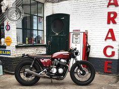 Maroon Honda CB 750 custom