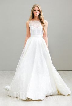 A sophisticated, A-line @lazarobridal wedding dress with an illusion neckline | Brides.com