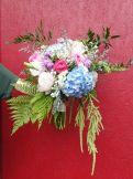 Alaska bridal bouquet with light blue hydrangea, lavender stock, lavender mini carnations, white spray roses, garden roses, lisianthus, wild ferns, green amaranthus, Italian ruscus, baby's breath, curly dusty miller and limonium. Deigned by Natasha Price of Alaskaknitnat.com