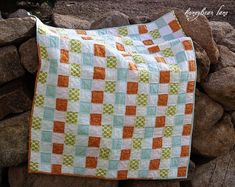 An almost No-sew quilt! The whole top is woven (basketweave), and after washing gives the quilt a shaggy/rag look. Awesome!.