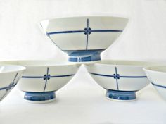 Sweet Vintage Asian Rice Bowls, Set of 5 made in Japan, these Blue & White Chinoiserie Porcelain Japan Bowls will be a bright statement on your table. Simple line pattern with 4 hearts. Use to serve rice, sauces, or on your night stand for your daily jewelry. Original stickers intact, Pier One Imports Made in Japan. Great condition, no chips or cracks. Measure 4 3/4 Diameter, 2 1/2 Tall.  Visit our shop for our unique and Eclectic Vintage selections: https://www.etsy.c...