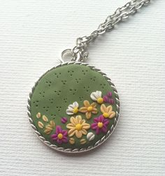 floral polymer clay pendant necklace. $13.00, via Etsy.