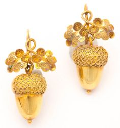 Gold Victorian acorn earrings; acorns are a symbol of potential.