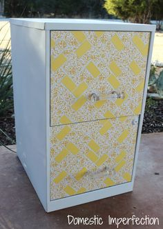 File cabinet makeover using paint, scrapbook paper, and Mod Podge.