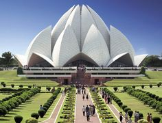 In New Delhi, India, popularly known as the Lotus Temple due to its flowerlike shape, is a Bahá'í House of Worship ~