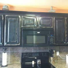 kitchen cabinets black above the fridge rustic cabinets amp wine rack my 2892