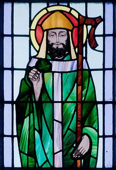 Stained glass portrait of St. Patrick from St. Benin's Church, County Galway, Ireland. Patrick is believed to have died on March 17, 460 OR 493. He is the patron saint of Ireland, Nigeria, Boston, and New York City.