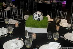 We could use a football instead. I also thought maybe we could place a glass pedestal in the center that the football sits on top of and we could light the inside of the glass under the football. Soccer Centerpieces, Bar Mitzvah Centerpieces, Party Table Decorations, Party Centerpieces, Party Themes, Soccer Birthday Parties, Soccer Party, 50th Birthday Party, Bar Mitzvah Party